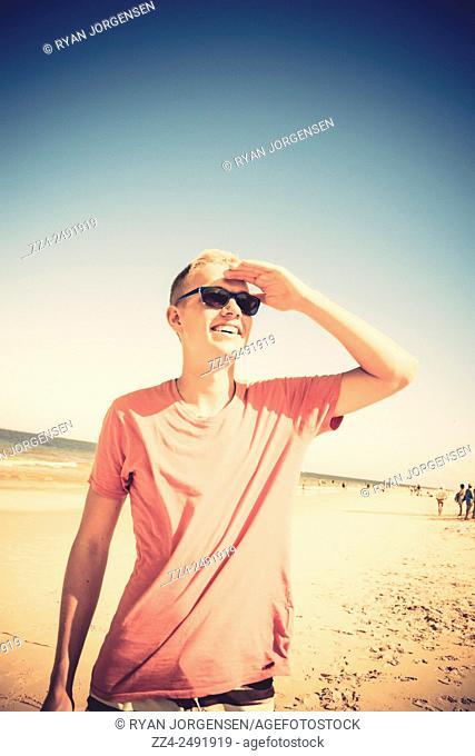 Instagram filtered photo of a man sightseeing tourist attractions at a Queensland beach. Taken Bribie Island, Australia