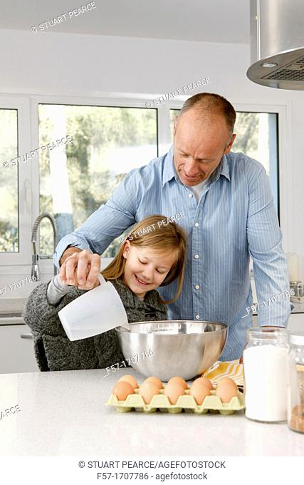 Father and daughter in the kitchen