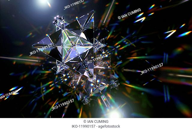 Abstract pattern of multicolored light trails and crystal triangle shapes