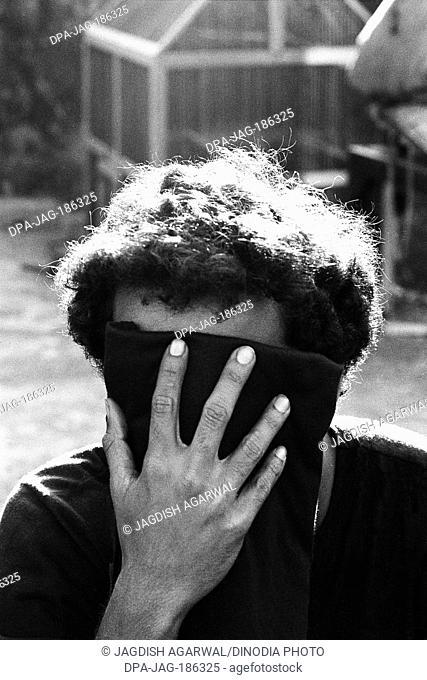 Drug addict expressing shame Mumbai Maharashtra India Asia 1986