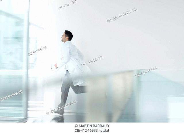 Doctor running in hospital