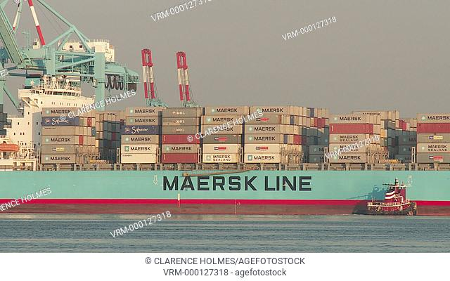ELIZABETH, NJ - JUNE 21: A tugboat helps make final adjustments to the position of a Maersk container ship upon arrival at the A.P