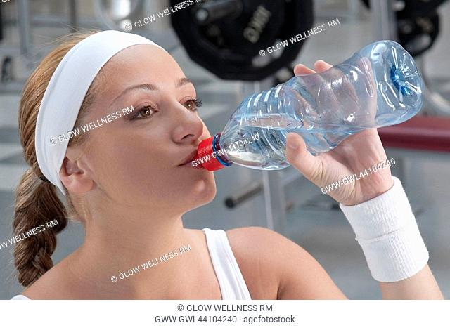 Woman drinking water from a water bottle