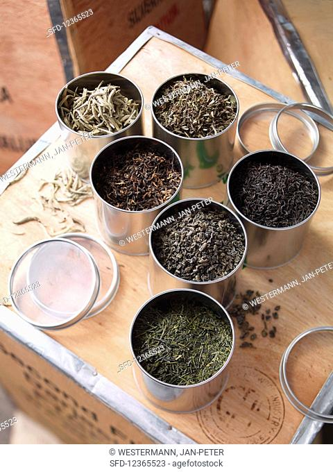 Various blends of tea in tea caddies