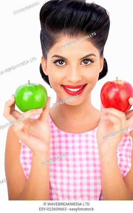 Happy black hair woman holding apples