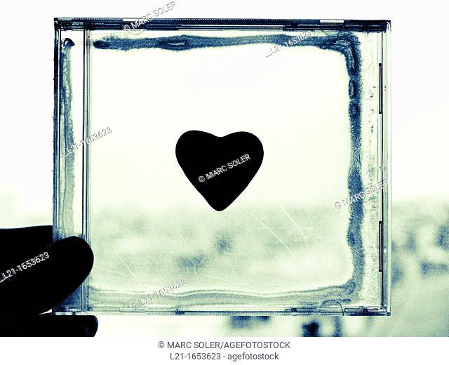 Black heart in a plastic square box