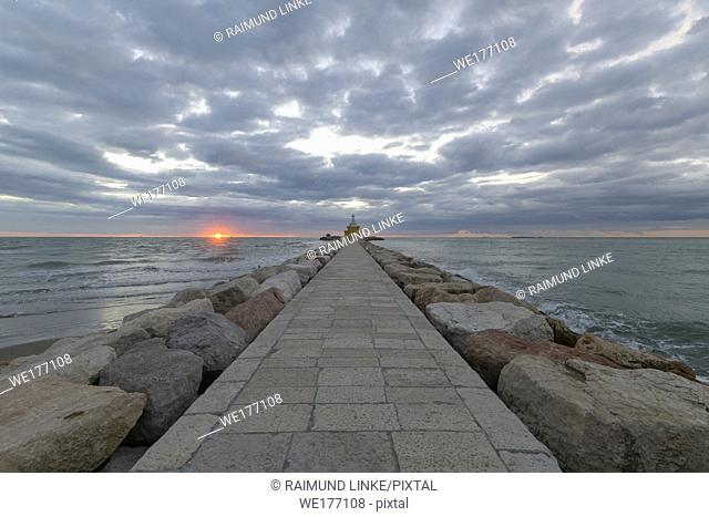 Dike and lighthouse at Sunrise, Punta Sabbioni, Venice, Venetian Lagoon, Mediterranean Sea, Veneto, Italy