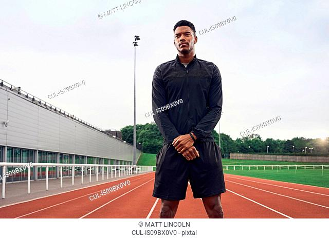 Portrait of athlete on running track