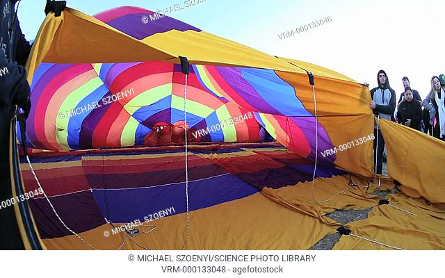 Group of people inflating a hot air balloon
