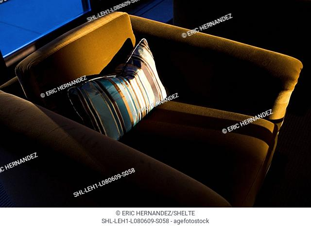 Modern armchair with striped pillow