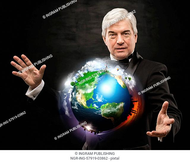 Global Business - A businessman holding world