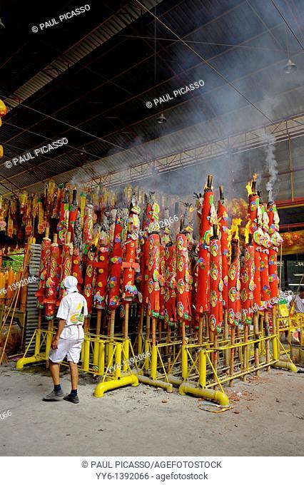 Devotees burning large candles, Vegetarian festival at San Jao Sieng Kong shrine , wat sung heng yee, Chinatown , Bangkok