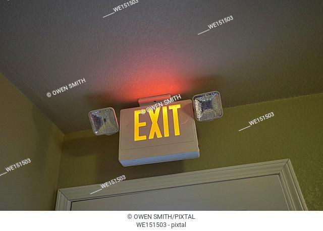 Neon Exit sign above Hotel Doorway