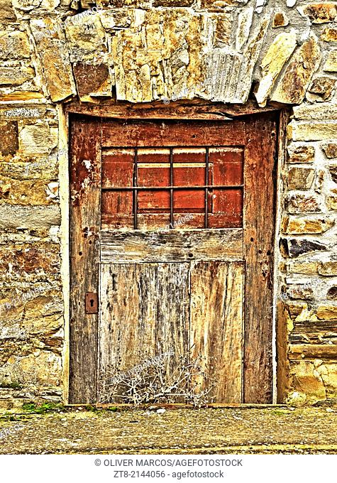 Cellar door of a house in an abandoned village, Leon province, Castilla-Leon, Spain