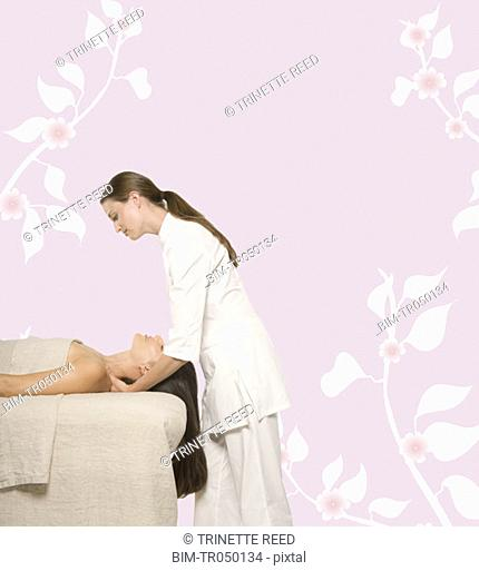 Woman having a massage against floral background
