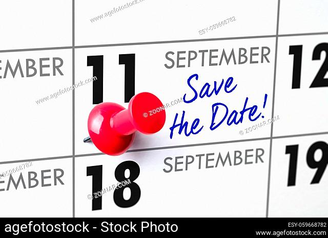 Wall calendar with a red pin - September 11