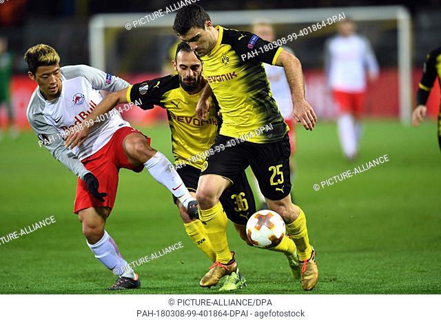 08 March 2018, Germany, Dortmund: Europa League match between Borussia Dortmund and RB Salzburg, Signal Iduna Park: Dortmund's Sokratis (R-L) and Omer Toprak in...