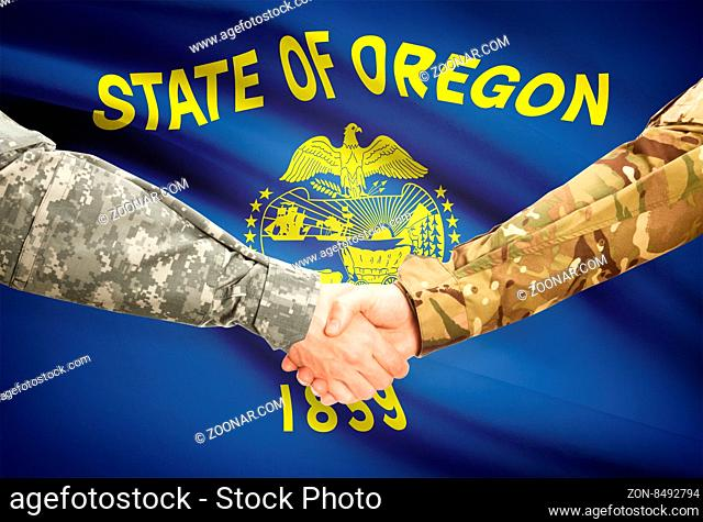 Soldiers handshake and US state flag - Oregon