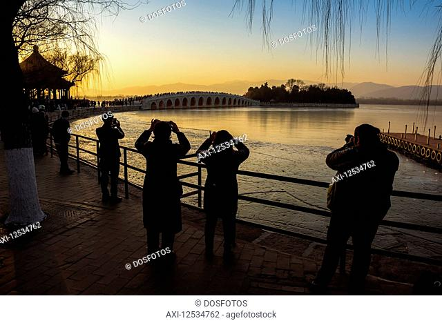 Sunset over Kunming Lake and the 17 Arch Bridge, The Summer Palace; Beijing, China