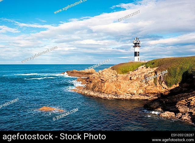 Pancha island lighthouse in Ribadeo coastline, Galicia, Spain