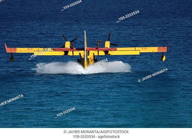 Canadair plane performing fire training maneuvers in Cala Clara, Sant Vicens, Mallorca, Balearic Islands, Spain