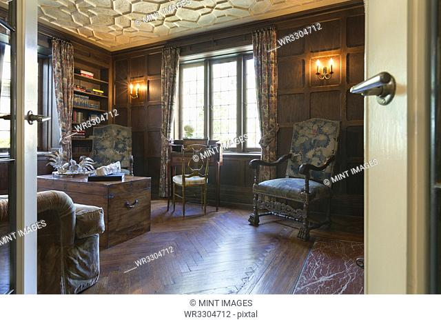 Chairs and trunk in ornate study