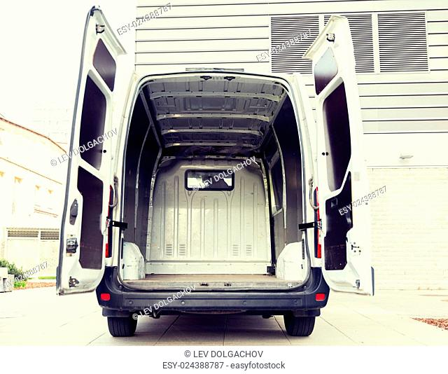 freight transportation, logistics, transport and vehicle concept - white empty minivan car with open doors on city parking