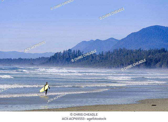 Surfer, Wickaninnish Beach, in Pacific Rim National Park near Tofino, British Columbia, Canada