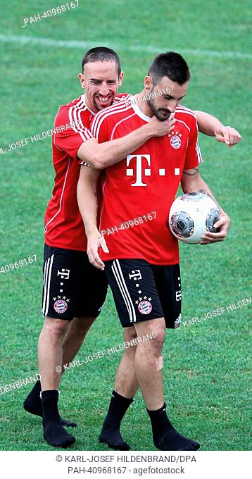 Bayern's Franck Ribery (L) and Diego Contento joke after the training in Arco, Italy, 10 July 2013. From 04 July to 12 July 2013 the Bundesliga soccer team...