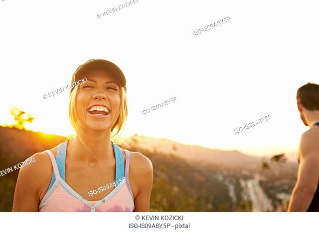 Woman laughing hard