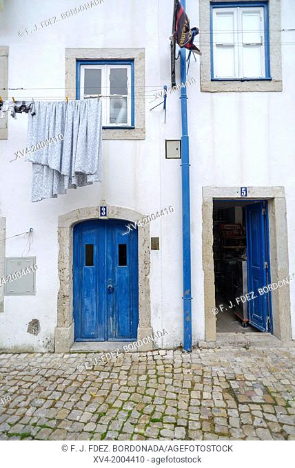 Facade with Blue door. Narrow streets around Castelo Sao Jorge. Alfama. Lisboa. Portugal. Europe