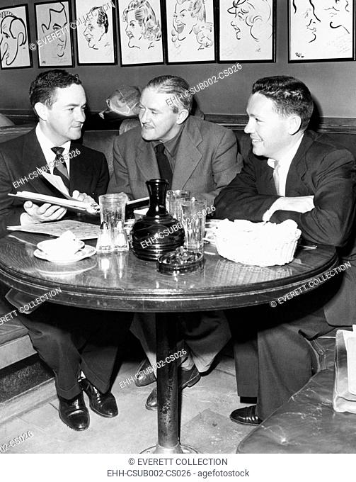 Radio script writers, Jerry Lawrence (left), and Bob Lee (right), with James Hilton (center). May 27, 1952. They were collaborating on a script based on the...