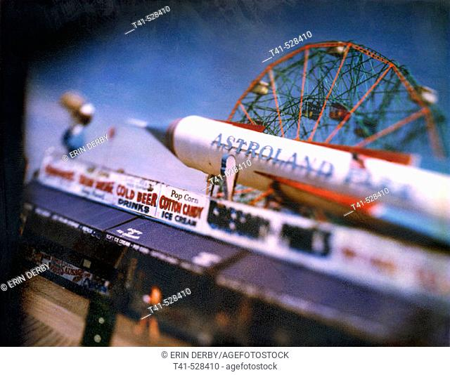 A polariod of the food vendors and some rides on the Coney Island shoreline in NY, USA
