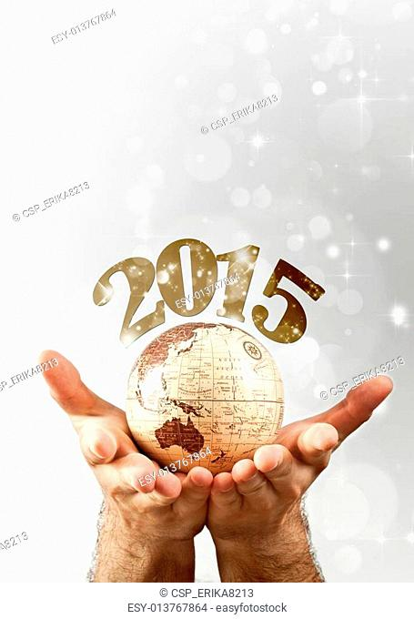 2015 over the globe earth hold by man`s hands