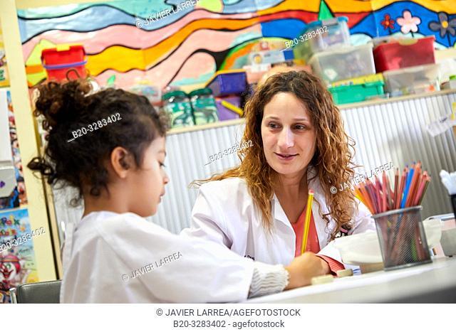 Teacher with children in a classroom of studies and games, Plant for hospitalization of children, Pediatrics, Medical care, Hospital Donostia, San Sebastian