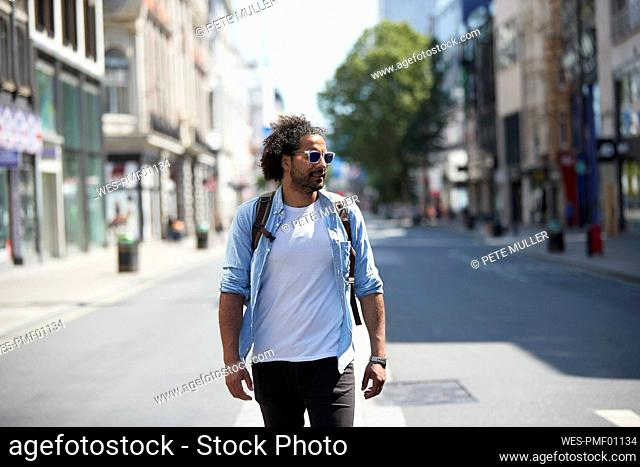 Portrait of young man in the city, Oxford Street, London, UK
