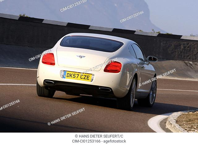Bentley Continental GT Speed, model year 2008-, white, driving, diagonal from the back, rear view, country road