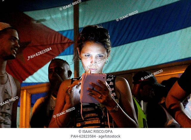 A young woman surfs the Internet at a public wifi spot in the district of Marianao in Havana, Cuba, 16 October 2015. Public wifi spots ensure enthusiasm amongst...