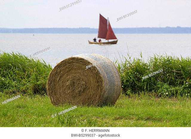bale of straw and Zeesenboot, Germany, Mecklenburg-Western Pomerania, Wustrow