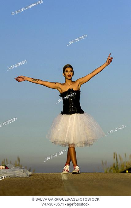 Woman with wedding dress and corset escaping from the ceremony