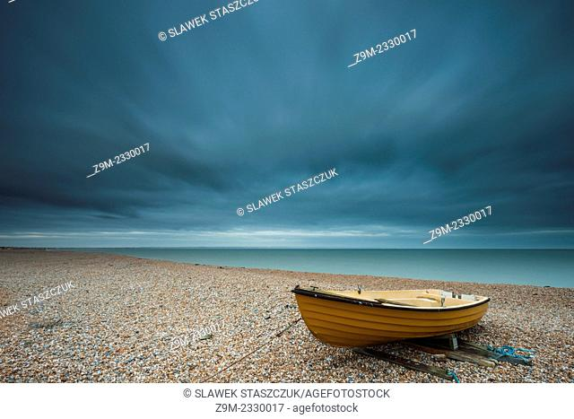 Modern rowing boat on the beach in Dungeness, Kent, England, United Kingdom