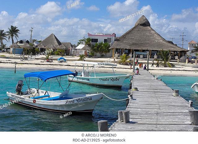 Fishing boats at landing stage, beach of Puerto Morelos, Riviera Maya, Quintana Roo, Yucatan, Mexico