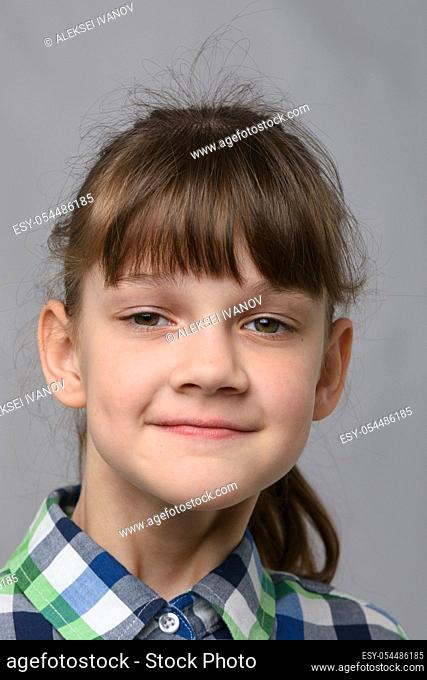 Portrait of a self-confident ten-year-old girl of European appearance, close-up