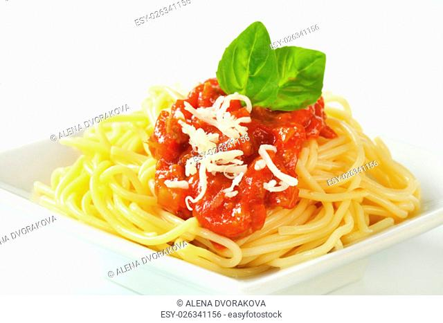 Spaghetti with meat-based tomato sauce and grated cheese