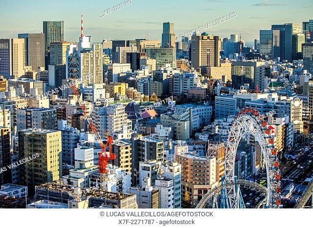 View of Bunkyo zone, at right Tokyo Dome City amusement park, Tokyo, Japan