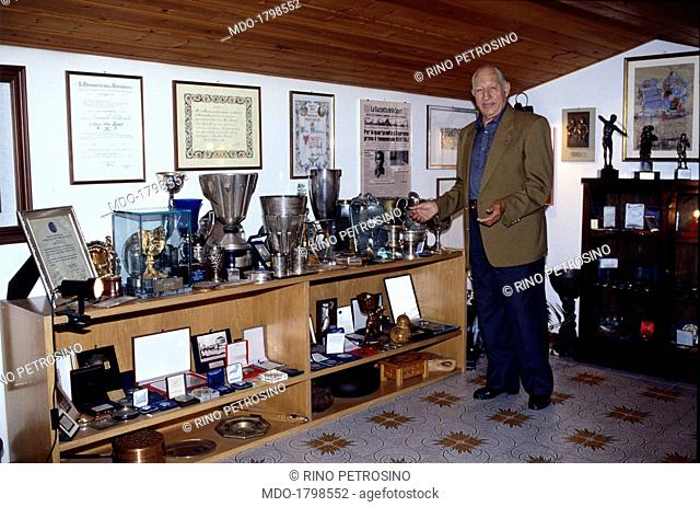 Former champion road cyclist Gino Bartali, taken into his home, shows to the camera some of the memorabilia of his long lasting and glorious career; Bartali...