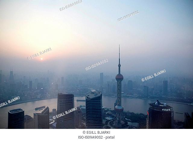 Oriental Pearl Tower and Huangpu River over misty cityscape, Shanghai, China