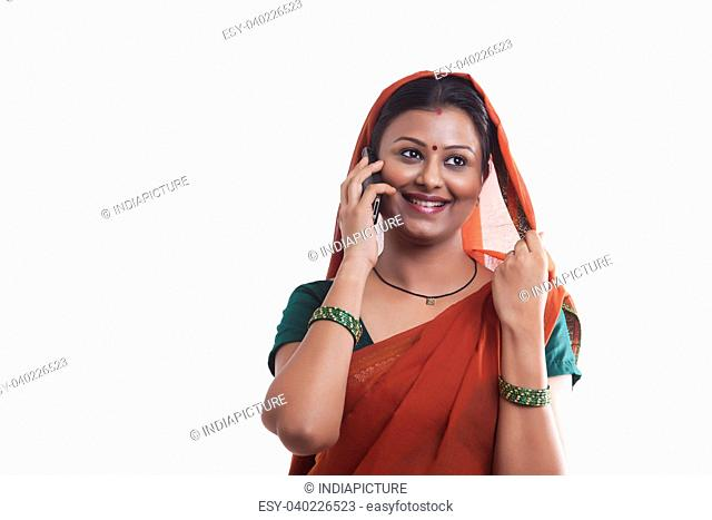 Rural woman talking on mobile phone