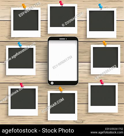 Smartphones with photo frames on the wooden background. Eps 10 vector file