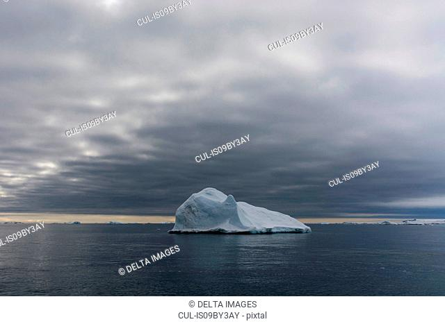 Iceberg under cloudy sky, Vibebukta, Austfonna, Nordaustlandet, Svalbard, Norway